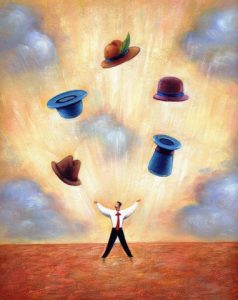 businessman juggling different hats